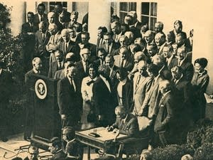 President Lyndon Johnson signs the legislation