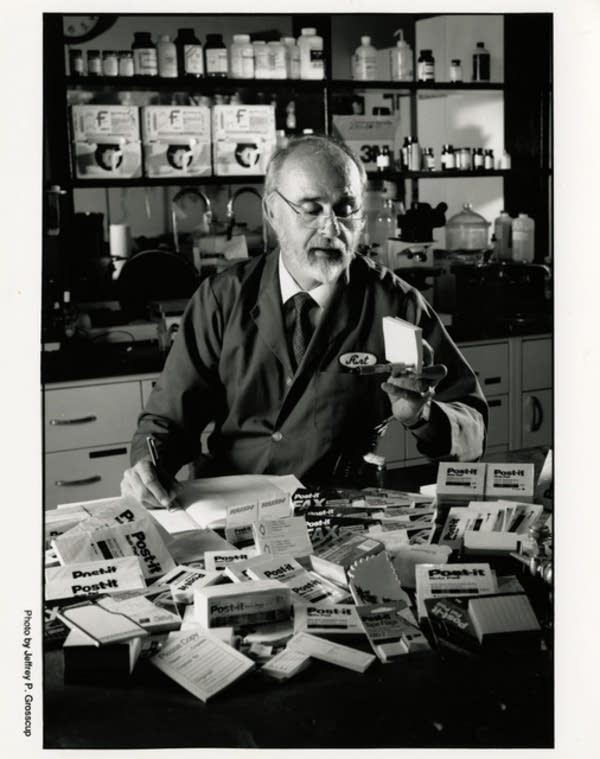 3M inventor Arthur Fry inspecting his invention, the Post-it Note.