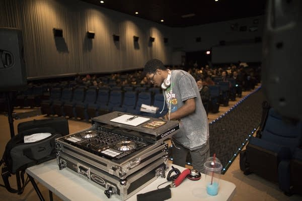 Sincere Arnett sets up DJ equipment for the Black Panther premiere party.