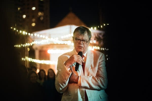 Garrison Keillor closes the night singing amongst crowd at street dance.