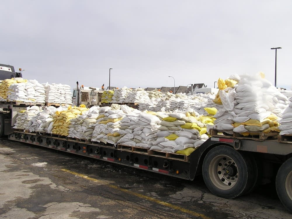 Sandbags wait to be transported from the Fargodome