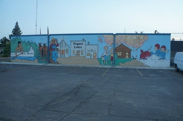 A mural showing people near a school.