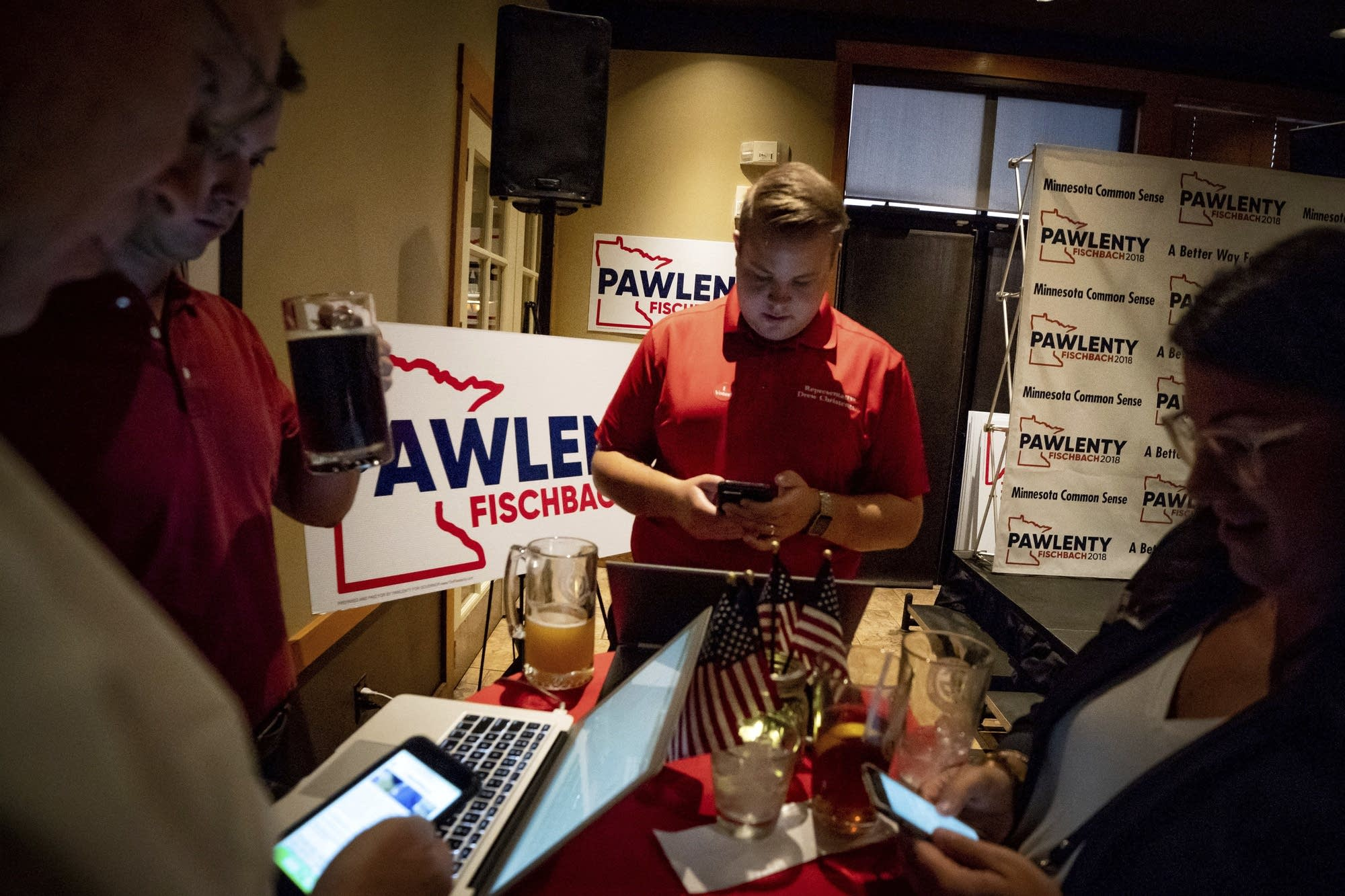Tim Pawlenty supporters check results at his election night gathering.