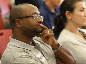 Brandyn Woodard listens to the MPR News Ground Level discussion.