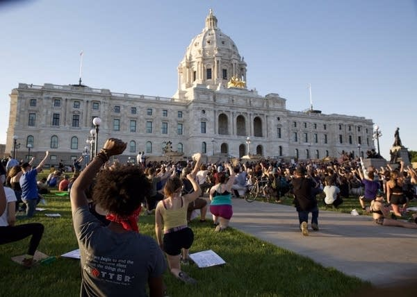 Several hundred protesters gather outside the State Capitol.