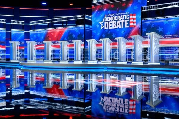 A stage lined with podiums for a debate.