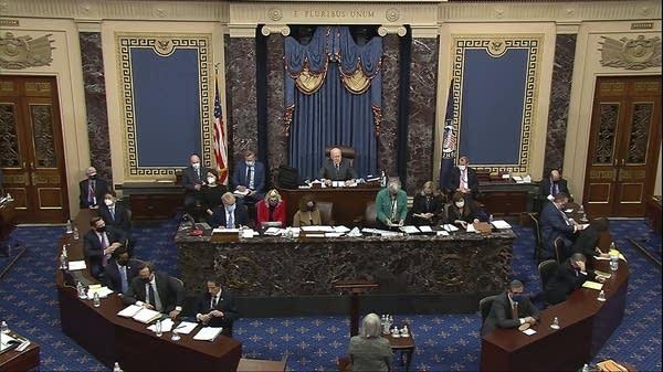 The Senate clerk reads the impeachment charge to senators