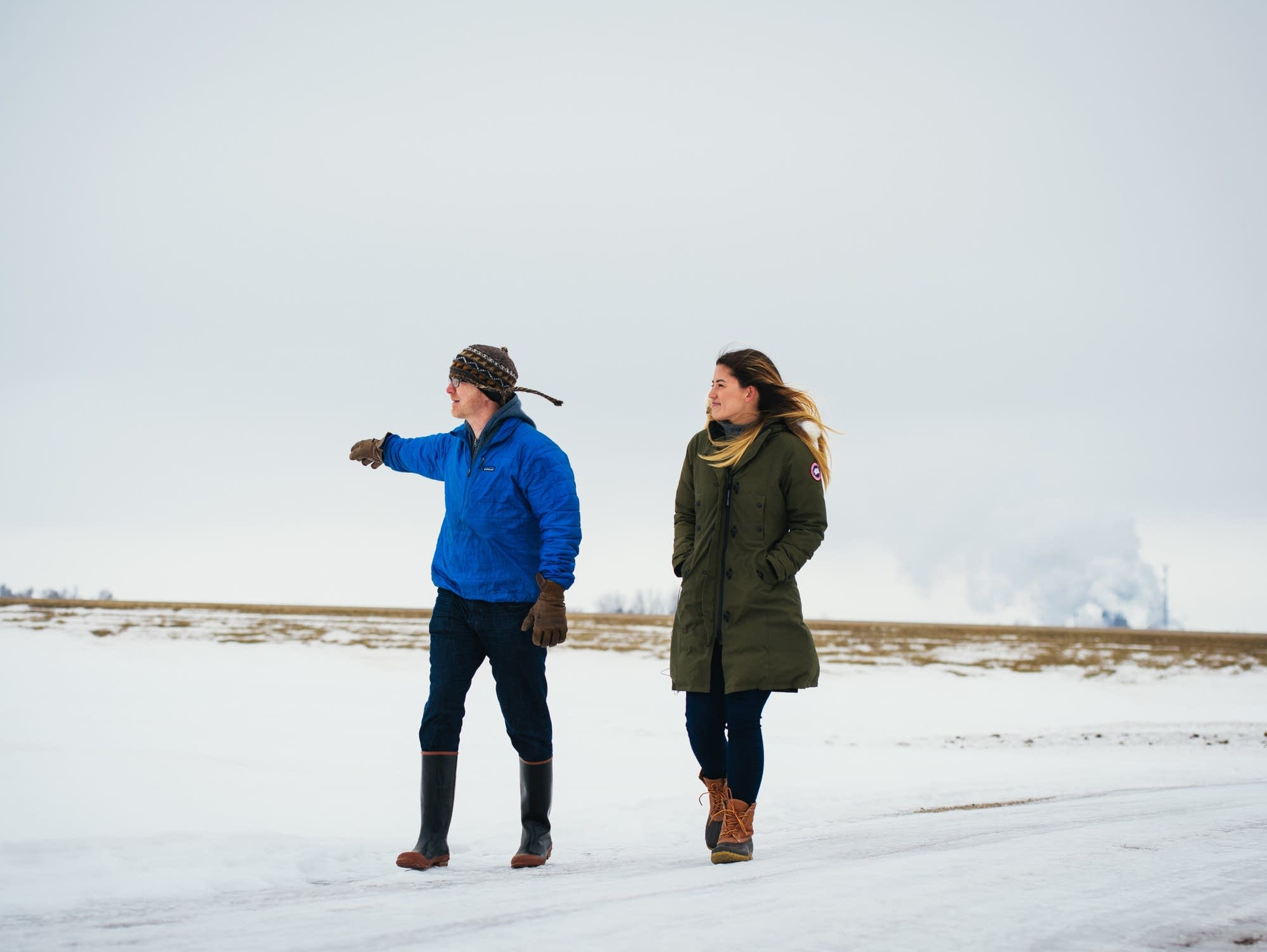 Fred Child looks across the beet field with Molly Yeh