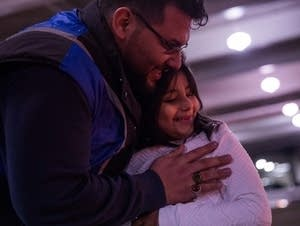 Hasanain Mohammed holds his daughter, Maryam.