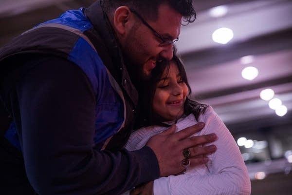 Hasanain Mohammed holds his daughter, Maryam.