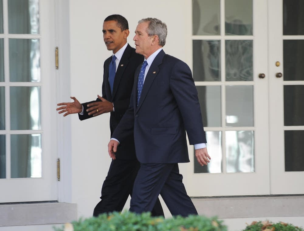 President George Bush walks with Barack Obama