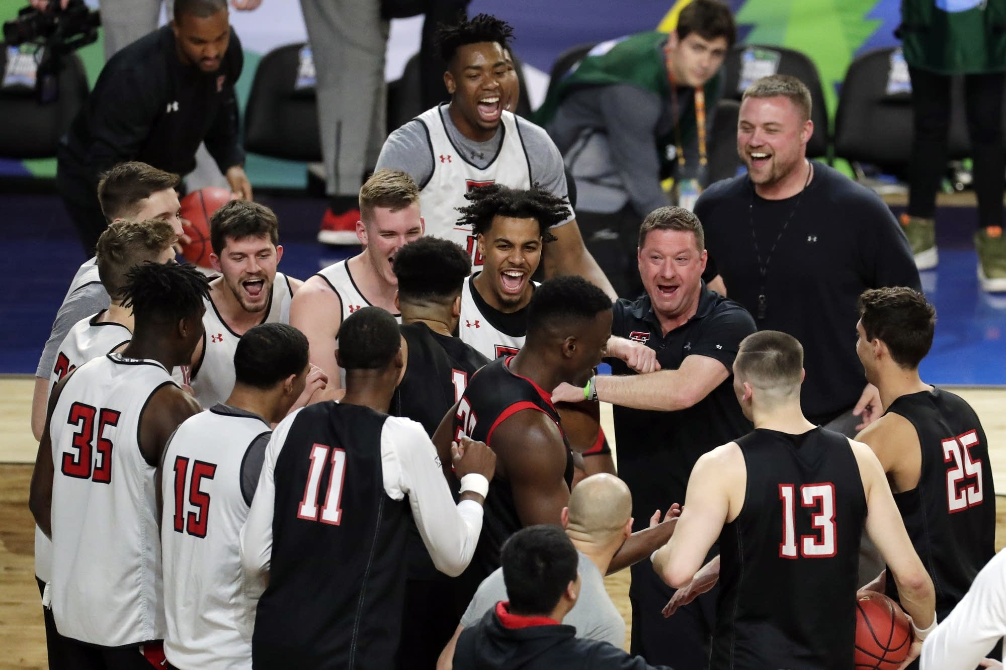 Texas Tech head coach Chris Beard laughs with his players in a huddle