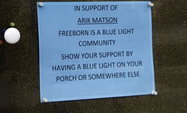 A sign reads In support of Arik Matson Freeborn is a blue light community