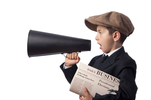 "Newsboy in ""Jeff cap"" holding Newspaper and Shouting in Megaphone"