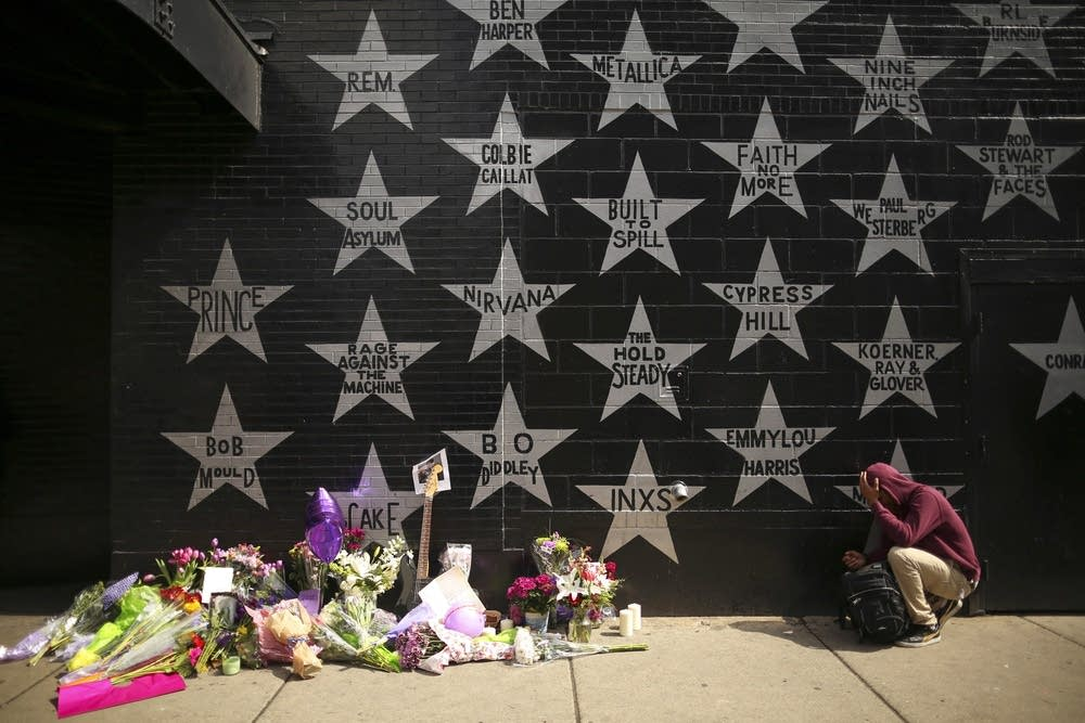 A fan grieves outside First Avenue in Minneapolis