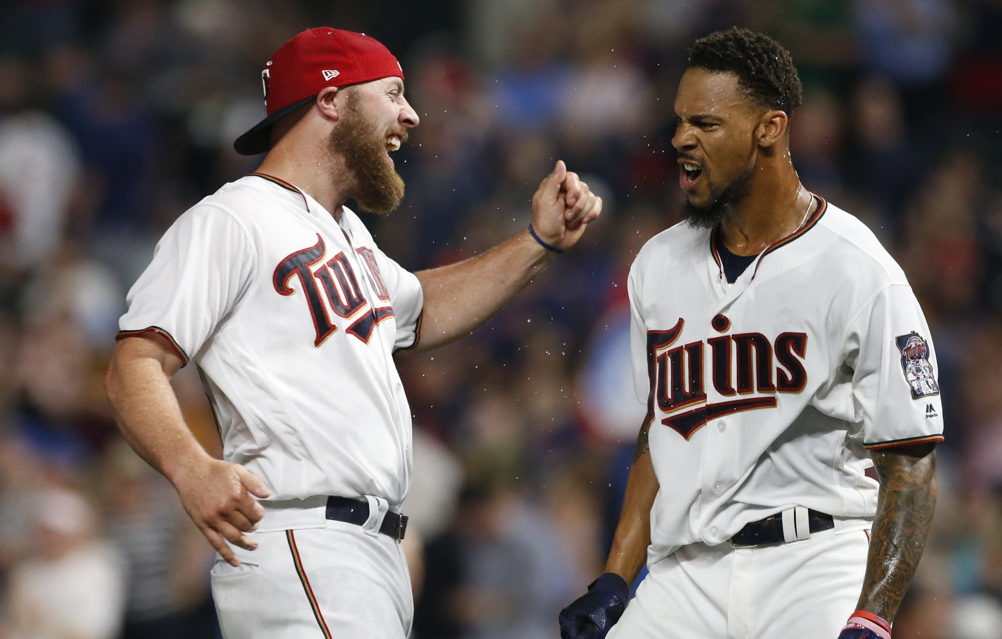 Twins' Chris Gimenez, left, celebrates with Byron Buxton.