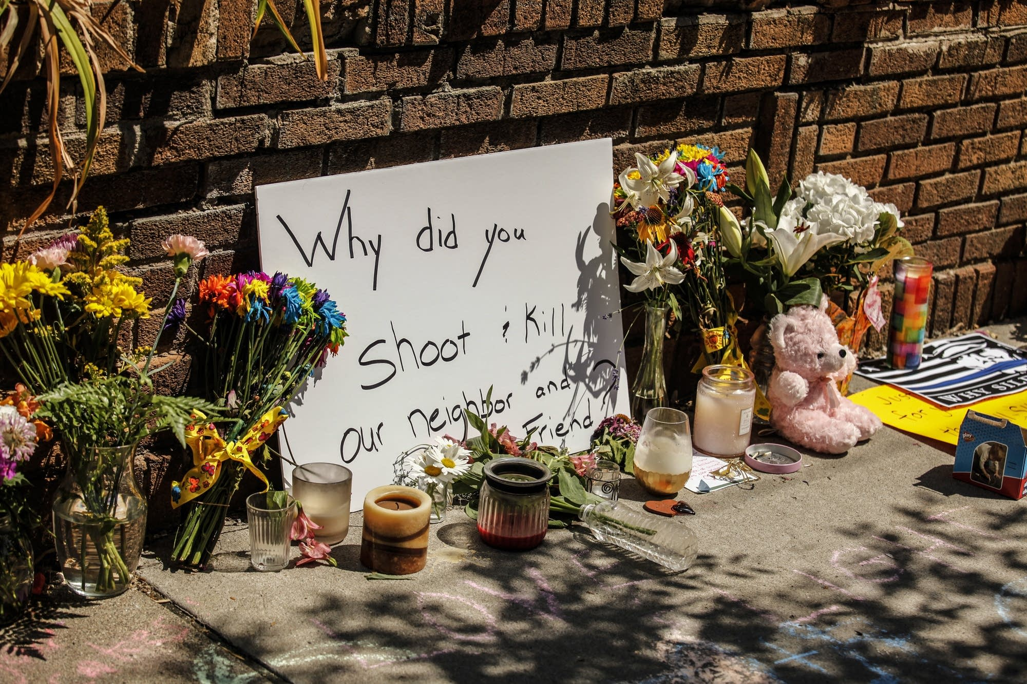 Flowers, letters and note cards were left by neighbors and friends.