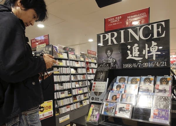 Looking at a CD of Prince's music