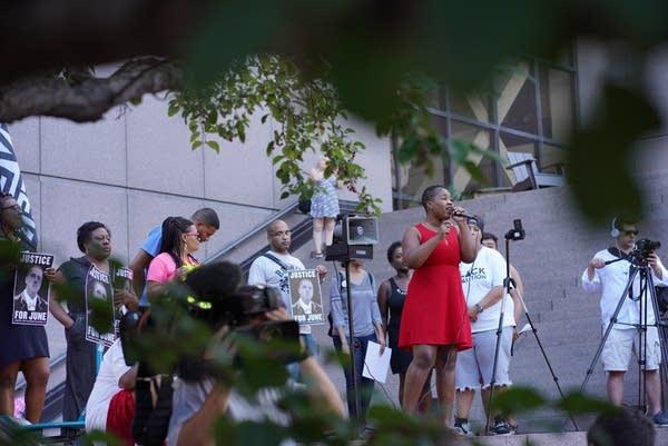 Minneapolis NAACP President Leslie Badu address the crowd.