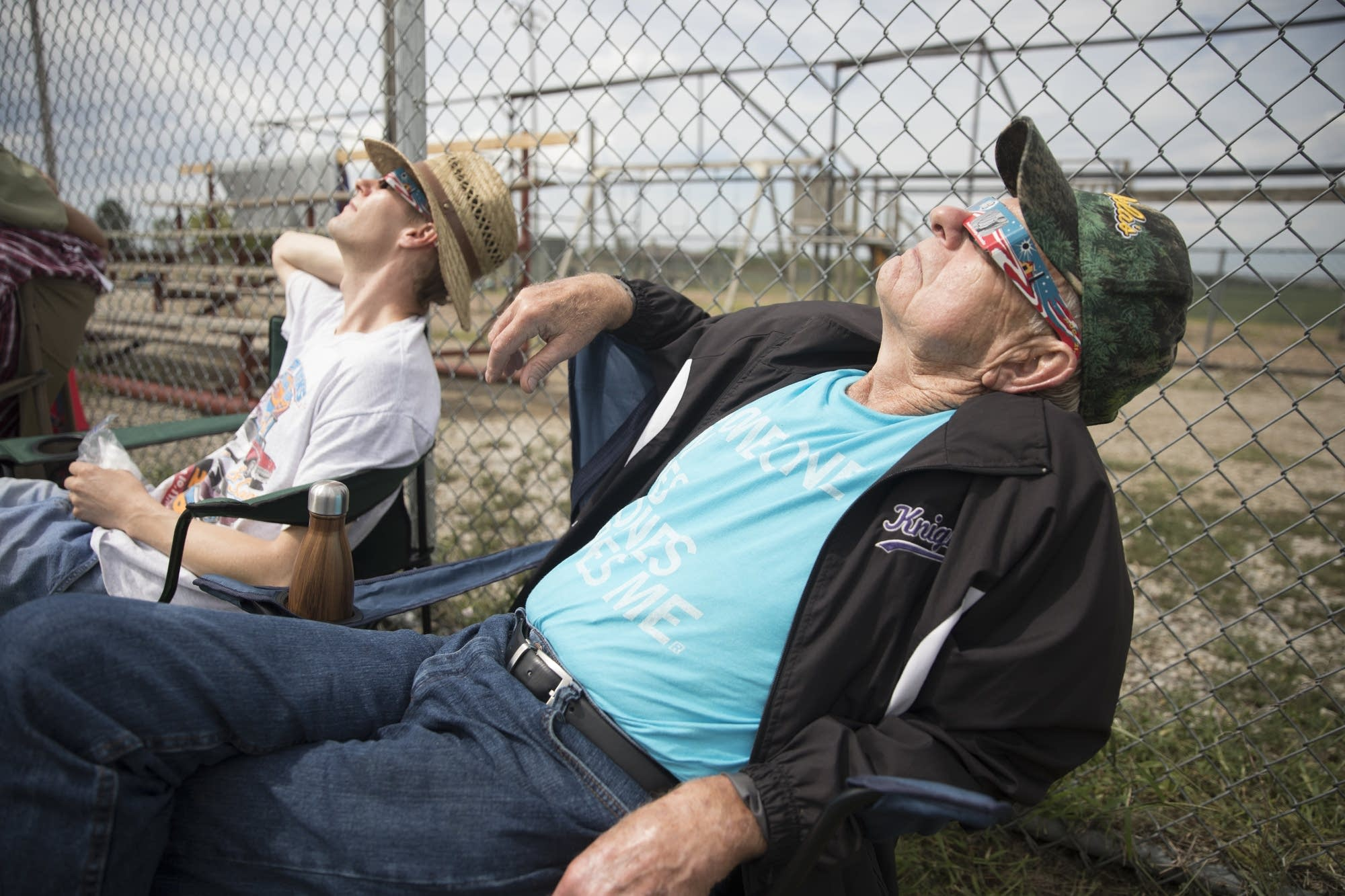 Clark Hammer, right, and Ryan Rasmussen sit back to watch the eclipse.