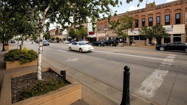 A car drives down a street