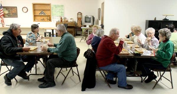 Seniors enjoy a meal