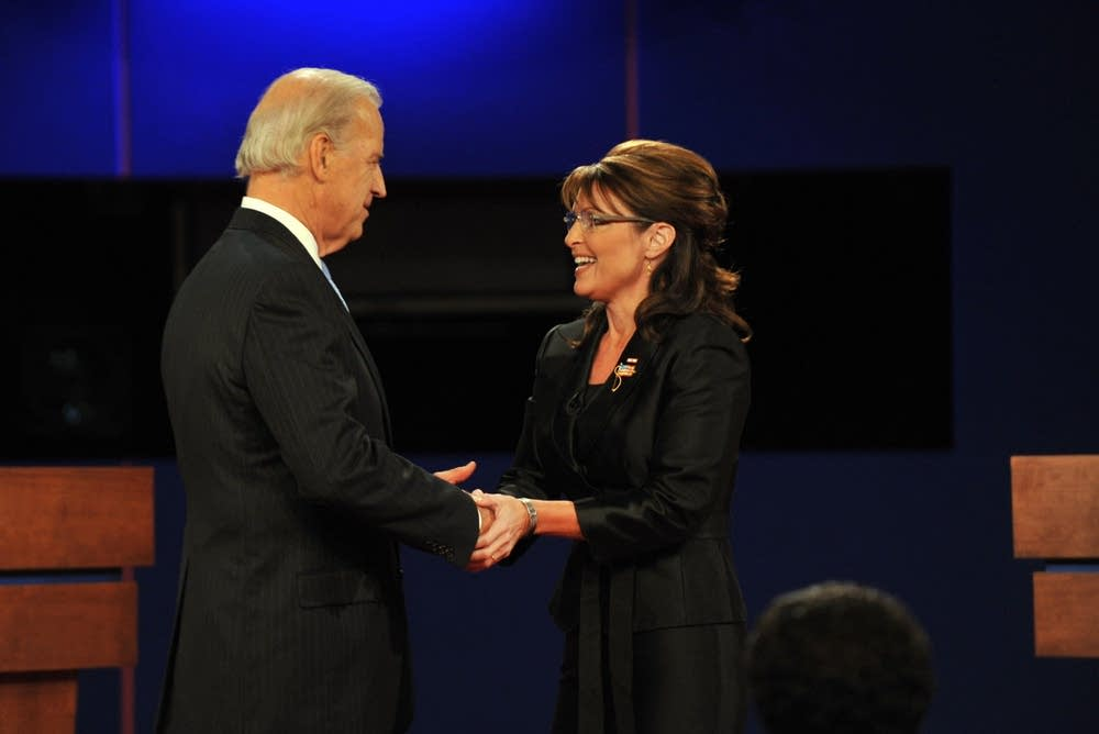 Republican Sarah Palin (R) greets Joe Biden