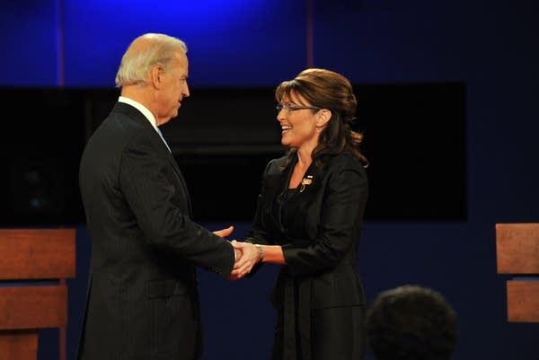 Republican Sarah Palin (R) greets Joe Biden