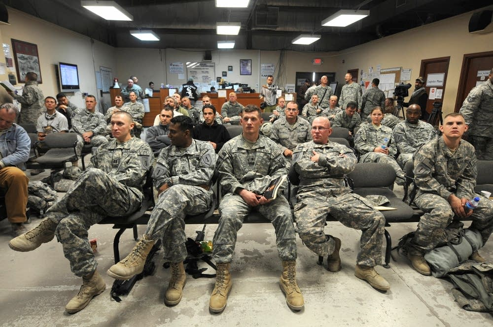 U.S. soldiers watch TV during the election results