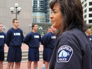 Minneapolis police chief Janee Harteau watched.