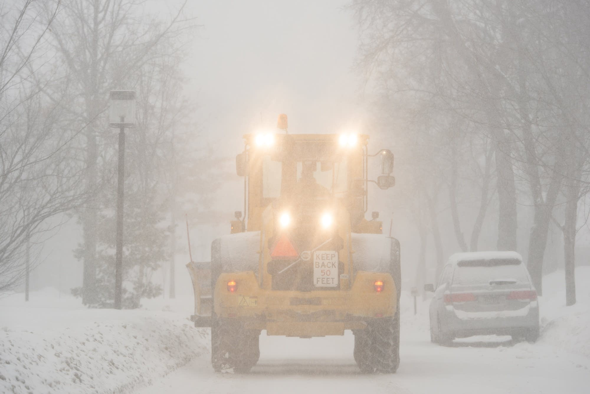 A snowplow drives along Dupont Ave. So. in Minneapolis.