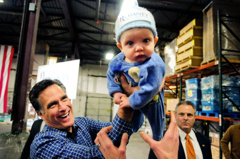 Romney passes off child