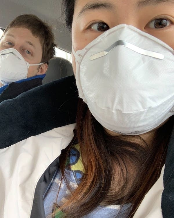 Two people wearing a mask.