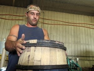 Mike Bellkey fits the heads into a barrel.