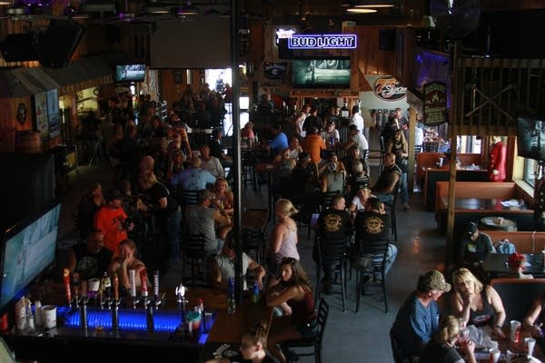 People fill a bar during the Sturgis Motorcycle Rally