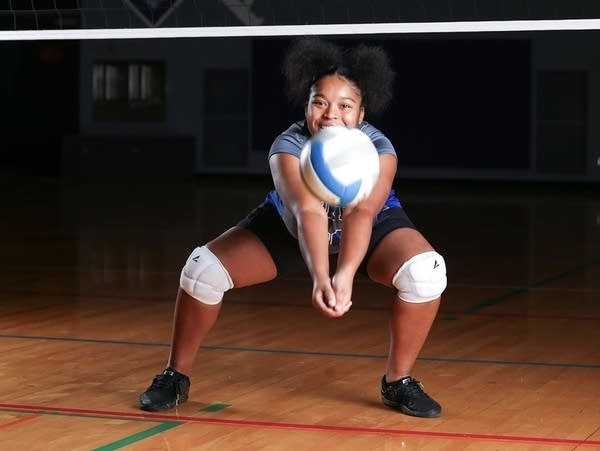 A student poses for a volleyball photo.