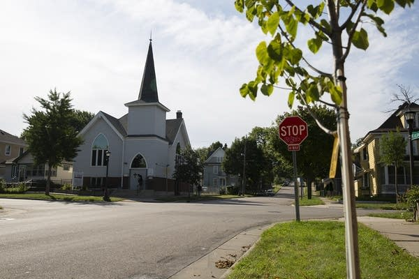 A church at the intersection of a street.