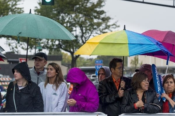 Spectators wait at the finish line.