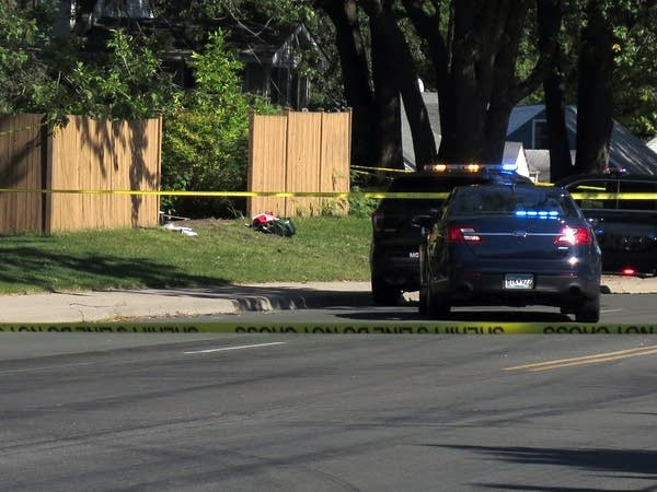 Police tape surrounds a scene near County Road H2 and Pinewood Court