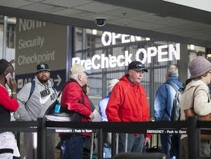 Passengers wait in line at MSP.