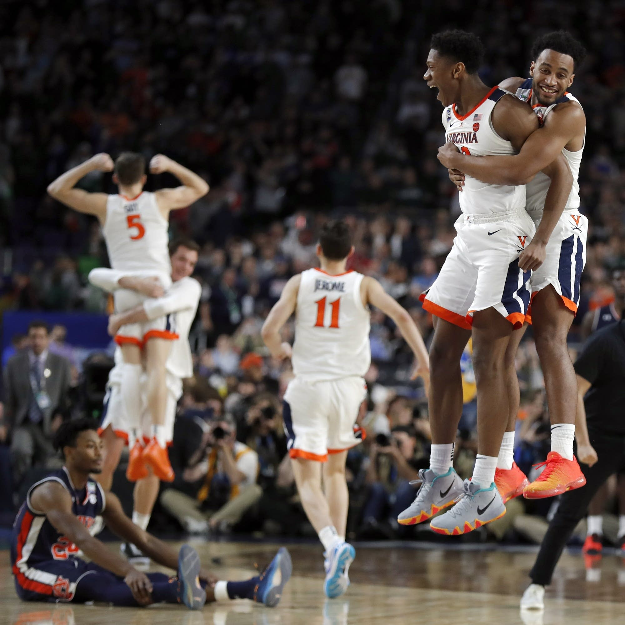 Virginia players celebrate after defeating Auburn