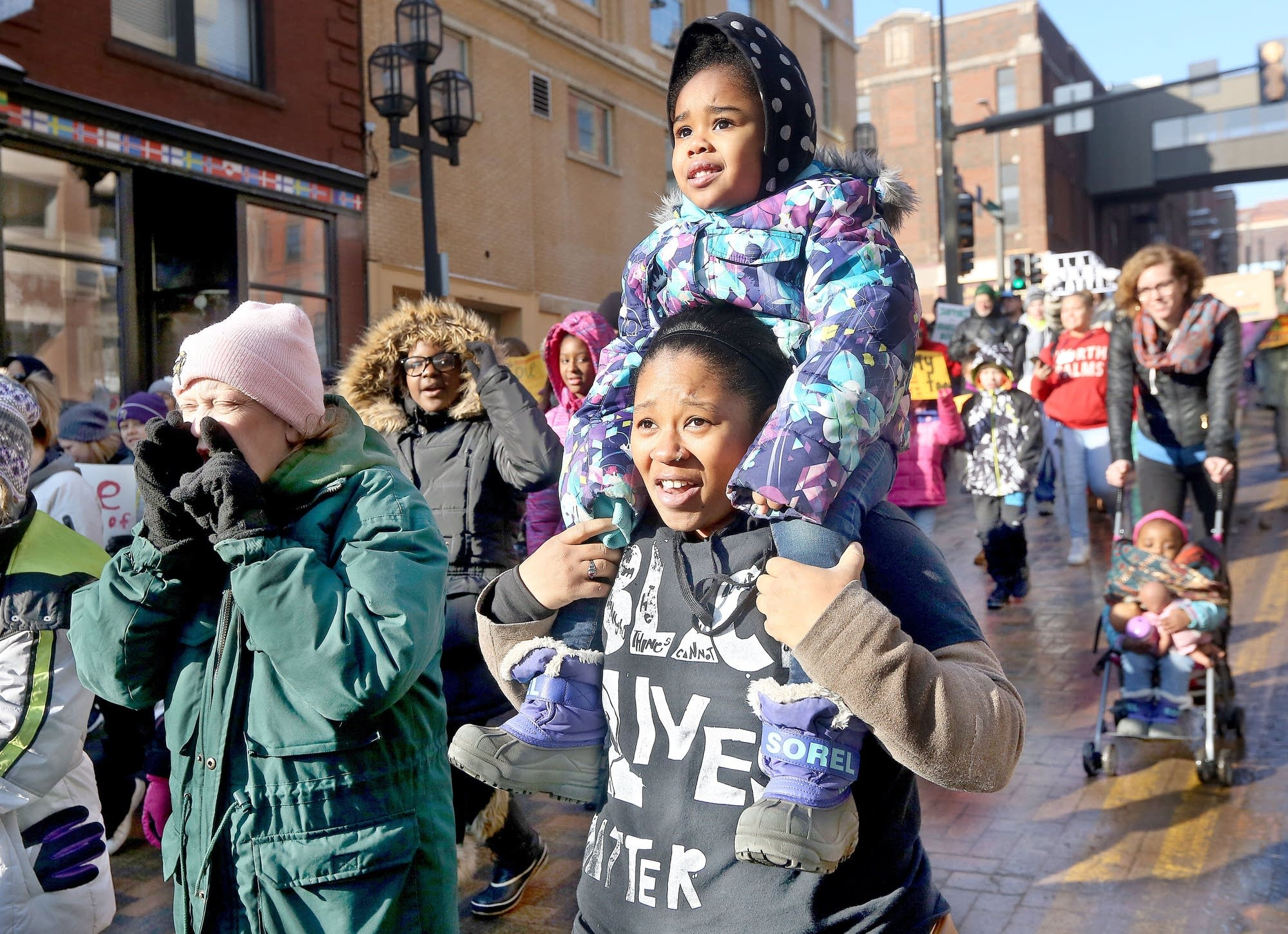 Porcha Shadd of Duluth carries her 3-year-old daughter.