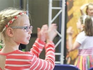 Girl claps to music