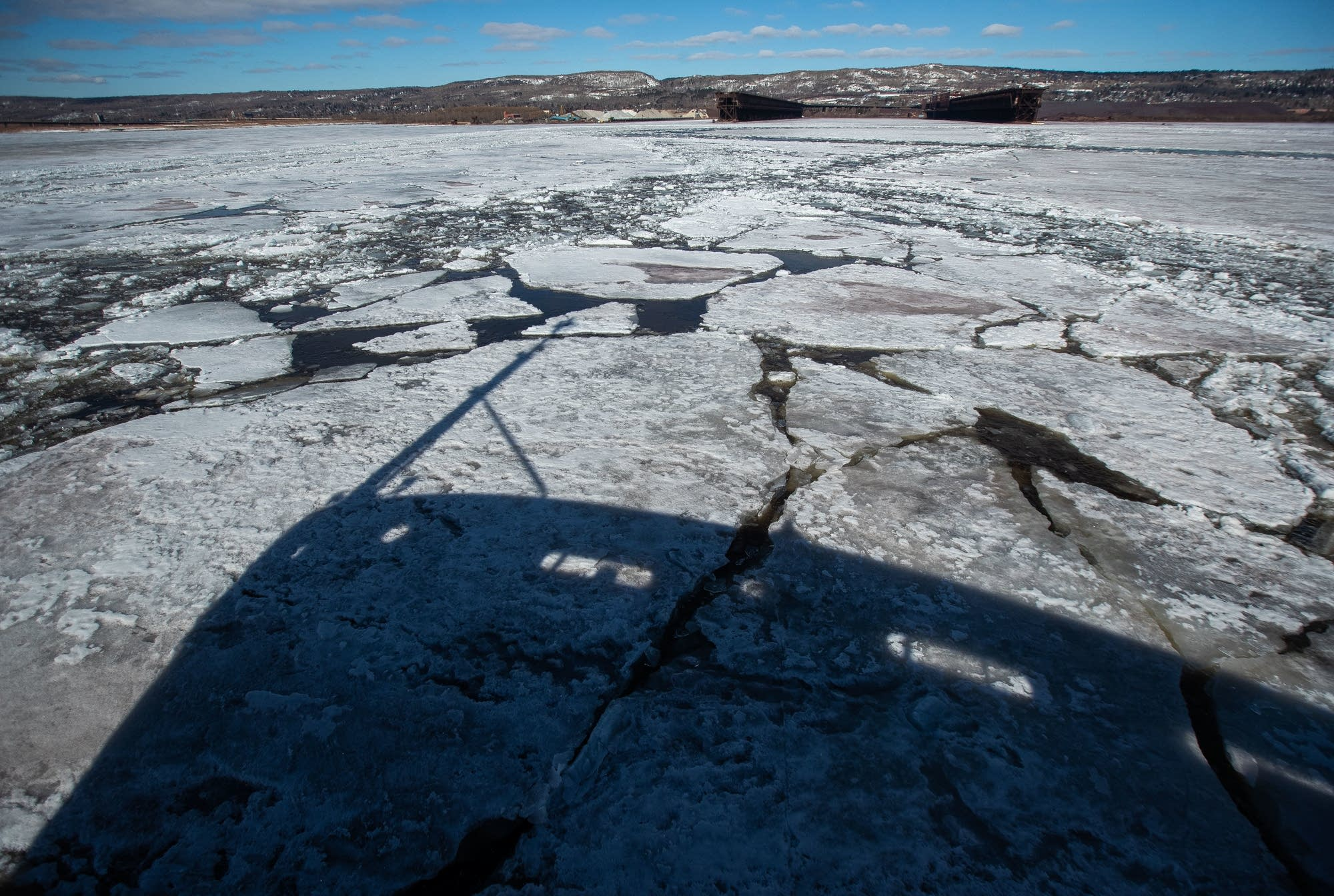A shadow of the U.S. Coast Guard Cutter Alder sits on the ice.