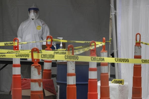 Medical worker in protective gear at coronavirus testing site
