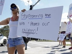 Juliana Cruz holds an anti-gun sign in Parkland, Fl., on February 17, 2018