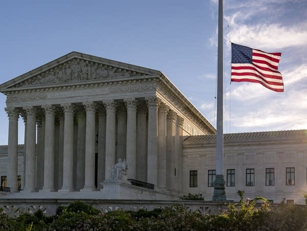The flag flies at half-staff at the Supreme Court
