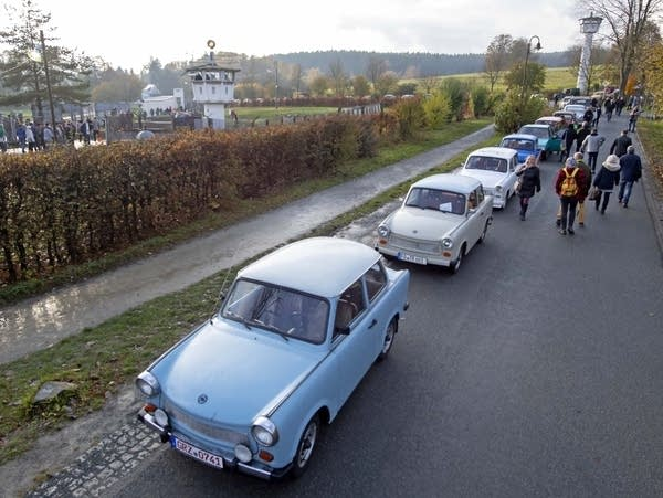 Legendary East German Trabant (Trabi) cars gather on a street