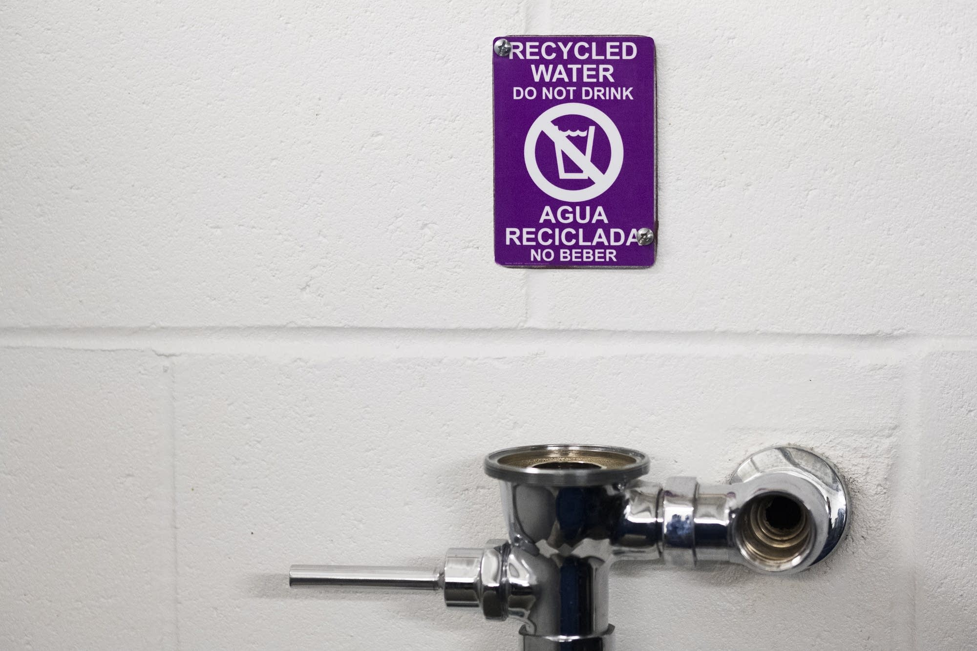 Signs warn fans not to drink from urinals