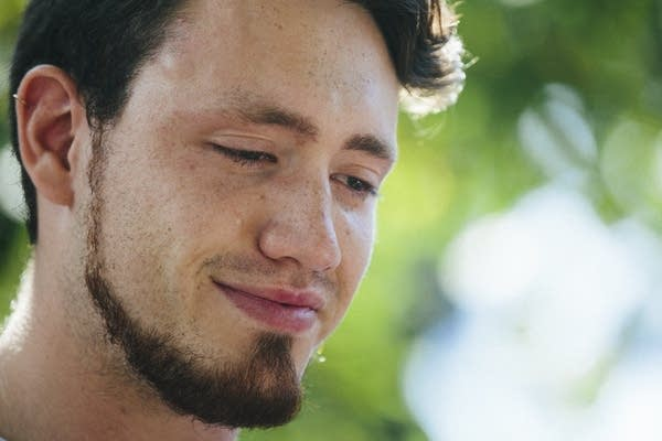 Tears run down Zach Damond's face as his father Don speaks.